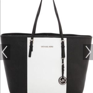 Michael Kors Bags - Black and white Mk tote bag. 95344dd9ed5ff